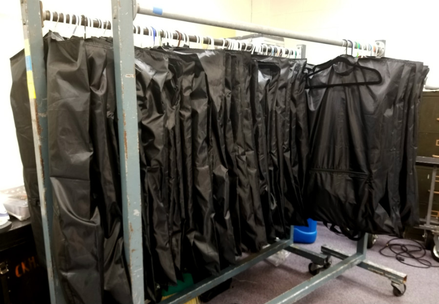 Marching Uniforms Hang Neatly in a Practice Room
