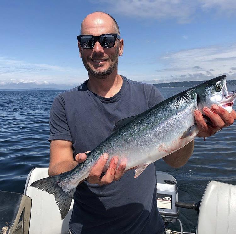 Vlach+showcasing+his+catch+during+a+salmon+fishing+trip+