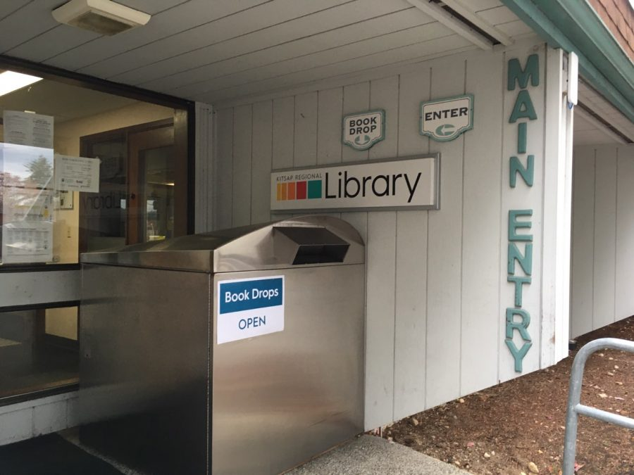 The main entrance to the Silverdale Branch of the  Kitsap Regional Library still has active book and audio/visual drop boxes for patrons to return books; after they've been returned, they are quarantined for 72 hours.