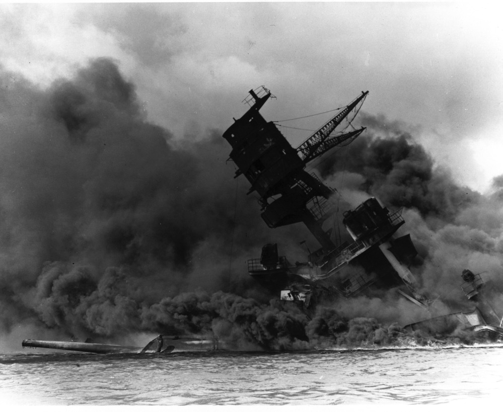 A US battleship, the USS Arizona, goes down after collapse of her forward magazines.