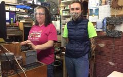 Both Shannon Randall and Sadie Flaherti work at the cash register, along with assisting costumers.