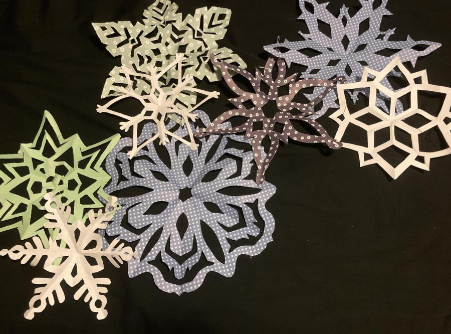 An array of hand made paper snowflakes made using the techniques in this article.